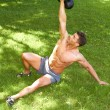 Working with kettlebell at outdoor — Stock Photo