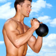 Muscular man working with weights — Stock Photo