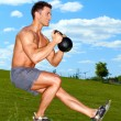 Exercises with kettlebell in sunny weather — Foto Stock