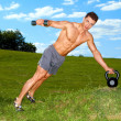 Fitness man practicing with weights — Stock Photo