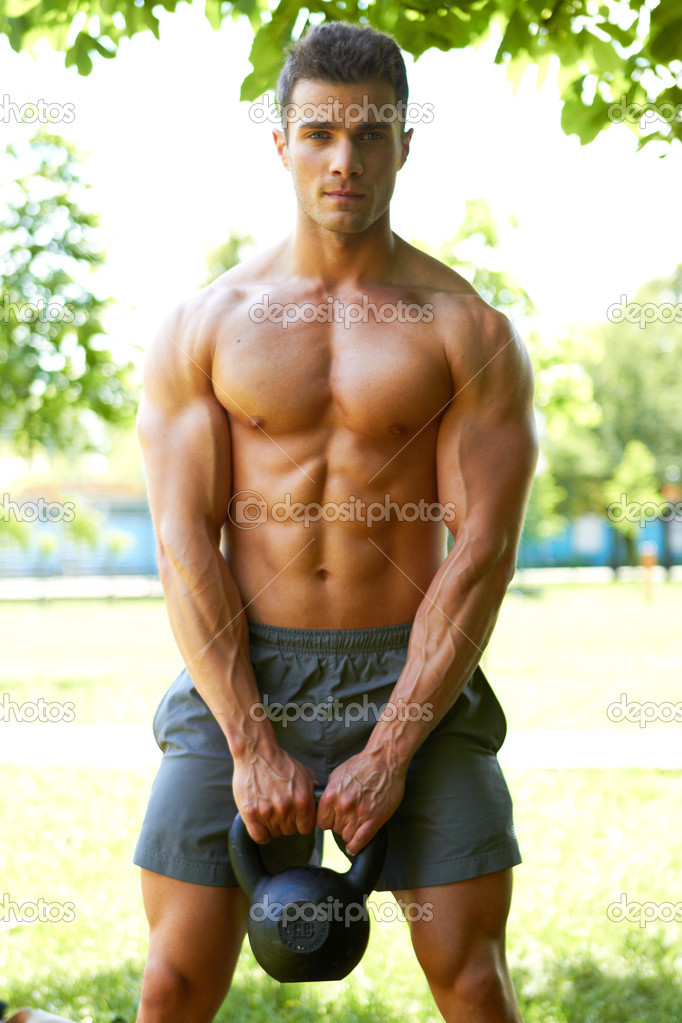 Handsome man during workout — Stock Photo © dashek #10904168