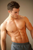 Portrait of a handsome young man with great physique — Stock Photo