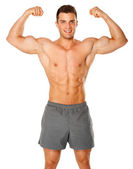 Fit and muscular man flexing his biceps on white — Stock Photo