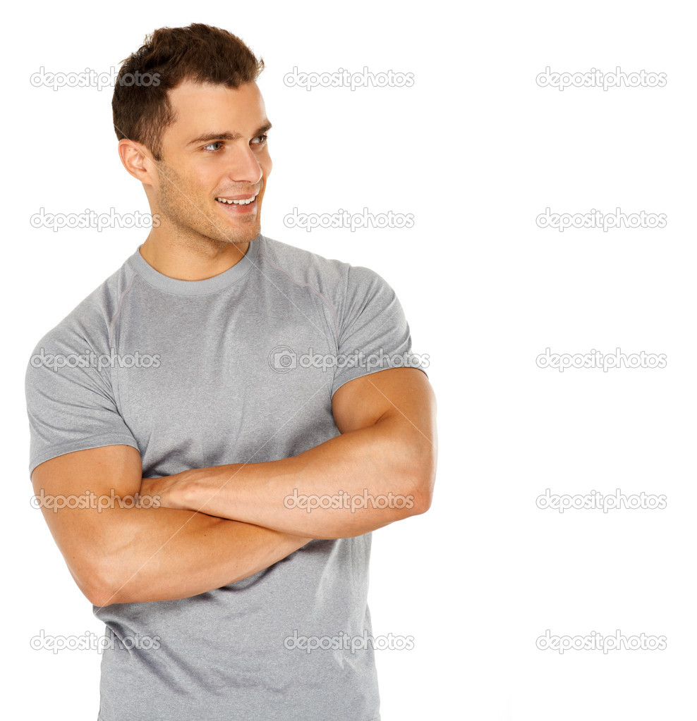 Handsome man with arms crossed looking his left on white background — Stock Photo #11134059