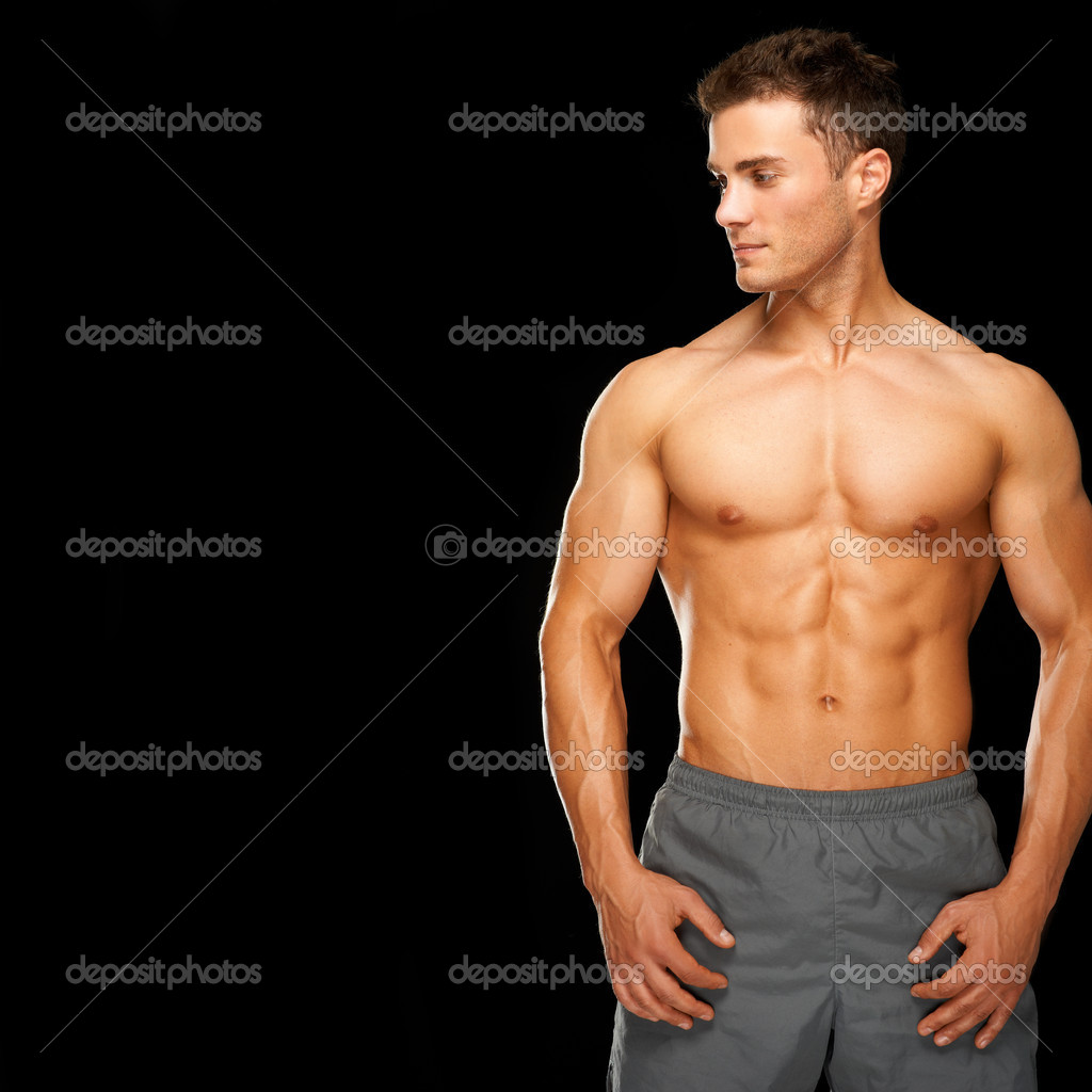 Sporty and healthy muscular man isolated on black background — Stock Photo #11134258
