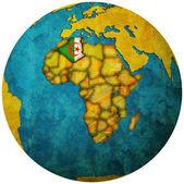 Algeria flag on globe map — Stock Photo