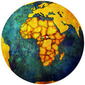 Central african republic flag on globe map — Stock fotografie