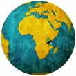 Tanzaniflag on globe map — Stock fotografie #11724618