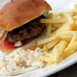 Hamburger and chips and coleslaw — Stock Photo