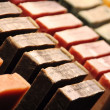 Rows of handmade soap displayed in a market — Stockfoto