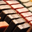 Rows of handmade soap displayed in a market — Stock fotografie