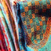 Multicolor fabric, material, shawls and scarves folded — Stock Photo