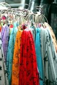Multicolor material, shawls and scarves hanging — Stock Photo