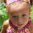 Stock Photo: Blue eyed mixed heritage baby girl