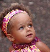 Blue eyed mixed heritage baby girl — Stock Photo