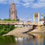 Bridge and weir through the small river Orlik — Stock Photo #10803261
