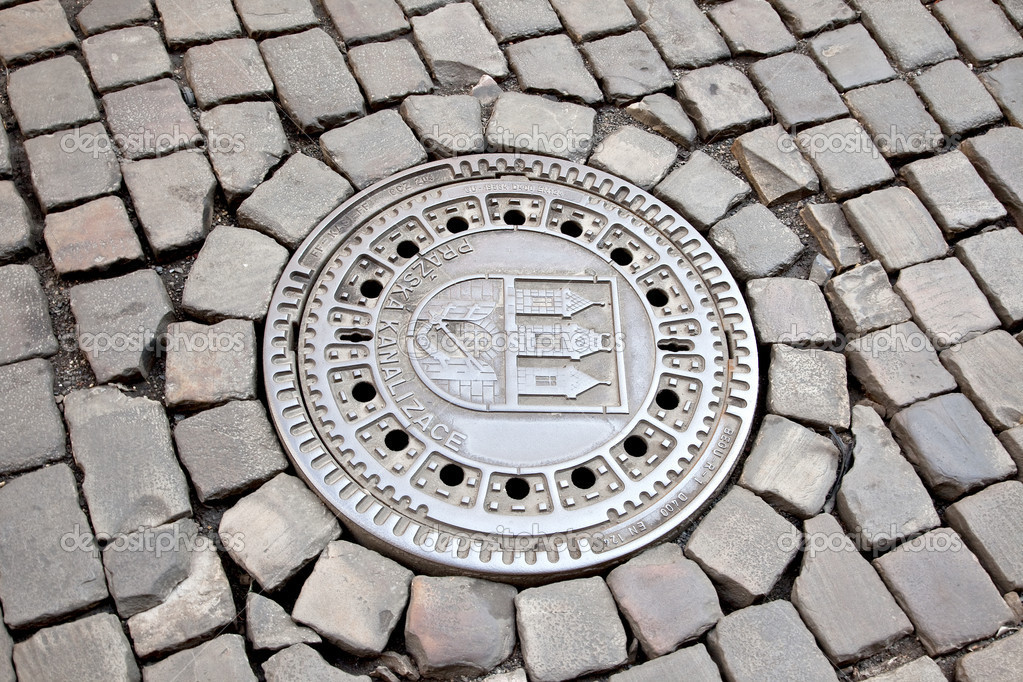 Metallic hatch. Entrance to the underground sewer communication  Stockfoto #11137201