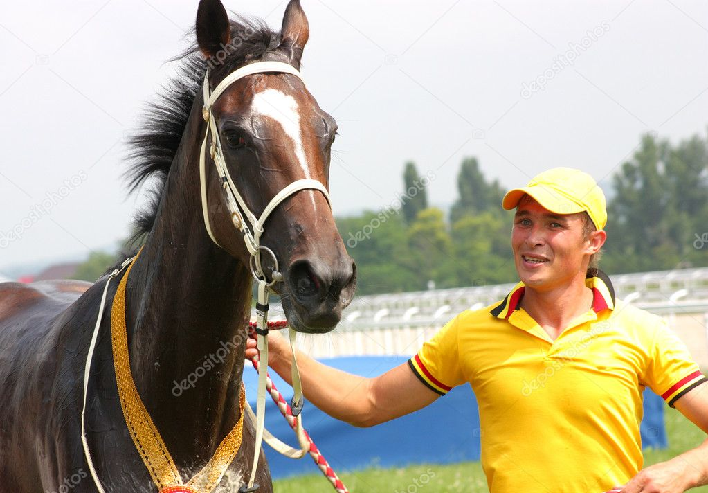 The jockey and  bay mare Gost Viktorius. Pyaigorsk,Northern Caucasus,Russia — Stock Photo #11561960