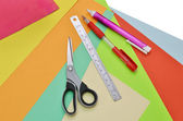 Closeup of papers, ruler, scissors, pencil and eraser — Stock Photo