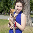 Beautiful teen girl walks in the park with a fox — Stock Photo