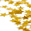 Christmas decoration of golden confetti stars — Stock Photo #10742116