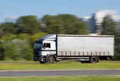 Truck in motion blur — Stock Photo