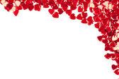 Confetti hearts on white background — Stock Photo