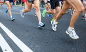 Running in city marathon on street — Stock Photo