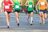 Running in city marathon on street — Stock Photo