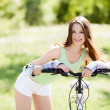 Woman riding a bicycle — Stock Photo #11035865