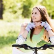 Woman riding a bicycle — Stock Photo #11035882