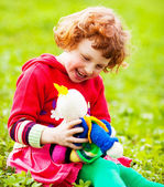 Child with a doll — Stock Photo