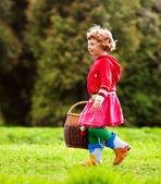 Girl with a basket — Stock Photo