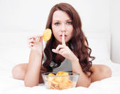 Woman with chips — Stock Photo