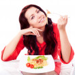 Woman eating spaghetti - Stock Photo