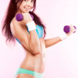 Woman with dumbbells — Stock Photo #11608097