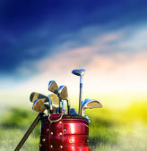 Golf clubs on grassy golf course — Stock Photo