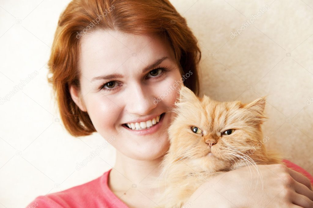 Young woman with Persian cat smiling portrait  Stock Photo #12185490