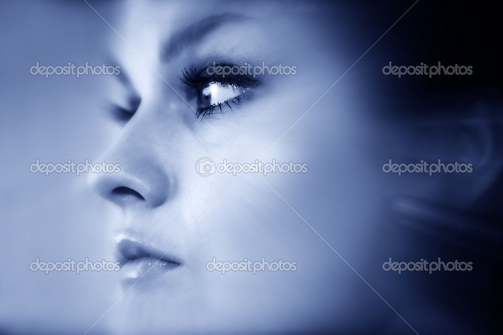 Young elegant lady face close up. Blue tone. — Stock Photo #12185539