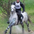 Stock Photo: Eventer on horse is overcomes Water jump