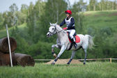 Cross-country. Unidentified rider on horse before Fixed obstacle — Stock Photo