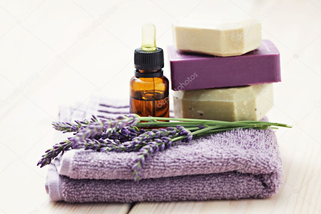 Essential oil with lavender flowers - health and beauty — Stock Photo #11757381
