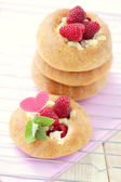 Buns with raspberries — Stock Photo
