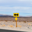 Stock Photo: Two sided black and yellow road sign designating two way traffic