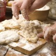 Royalty-Free Stock Photo: Detail of hands kneading dough