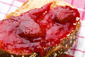 Sweet bread ( challah ) with strawberry jam — Stock Photo