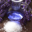 Lavender flowers with the bath salt and essential oil — Stock Photo #11446996