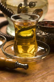 Cup of turkish tea and hookah served in traditional style — Foto Stock