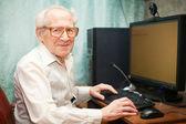 Smiling Senior Man Near Computer — Stock Photo