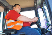 The driver working in the cabin of the truck — Stock Photo